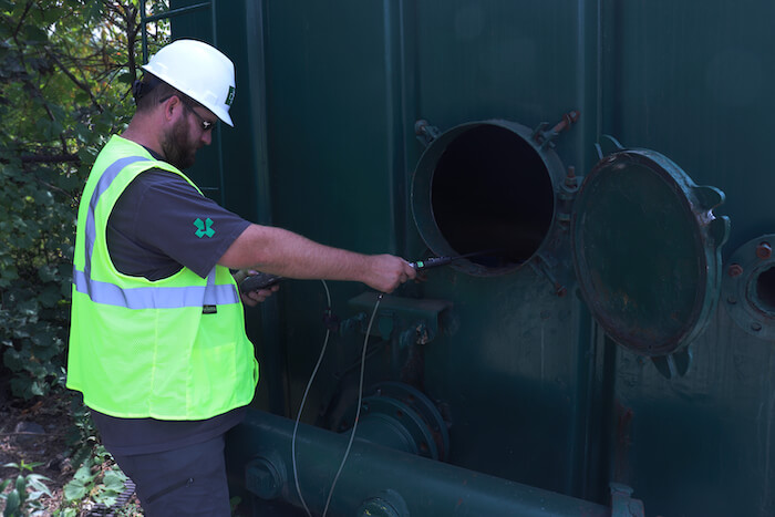 Photo of someone testing for a confined space job